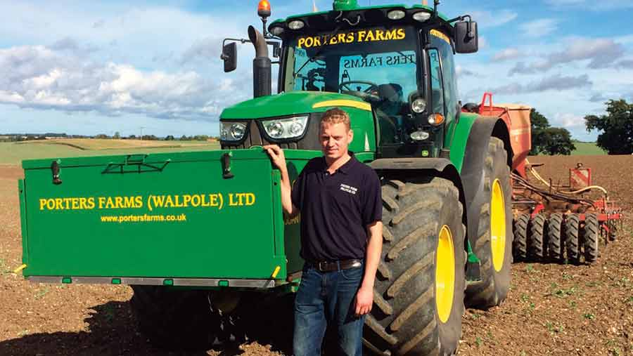 James Porter in front of a tractor