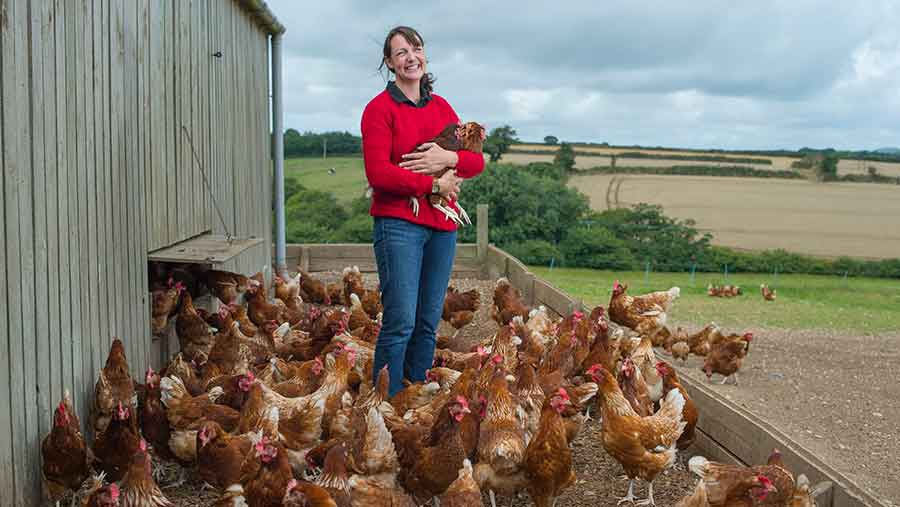 Rebecca Tonks with her flock of chickens