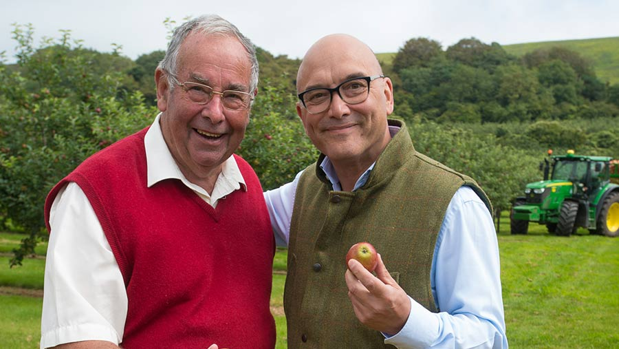 John Thatcher stands next to Gregg Wallace who is clutching an apple