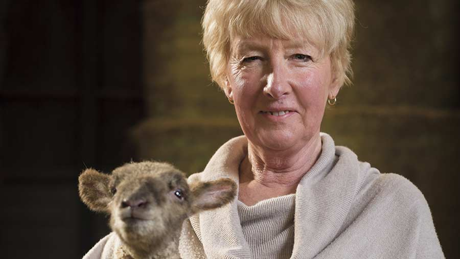 Bobbi Mothersdale with a lamb