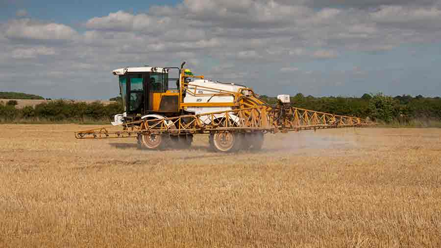 Knight self propelled sprayer applying Glyphosate to wheat stubble