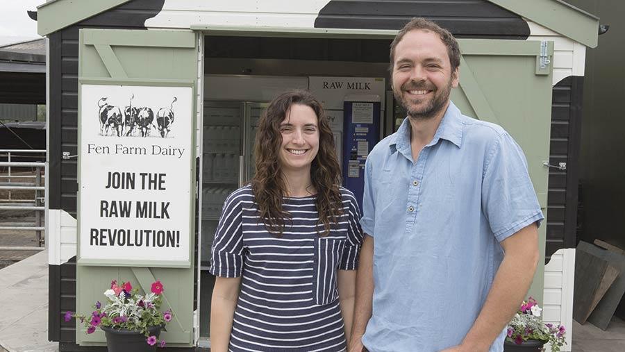 Dulcie and Jonny Crickmore stand on their farm