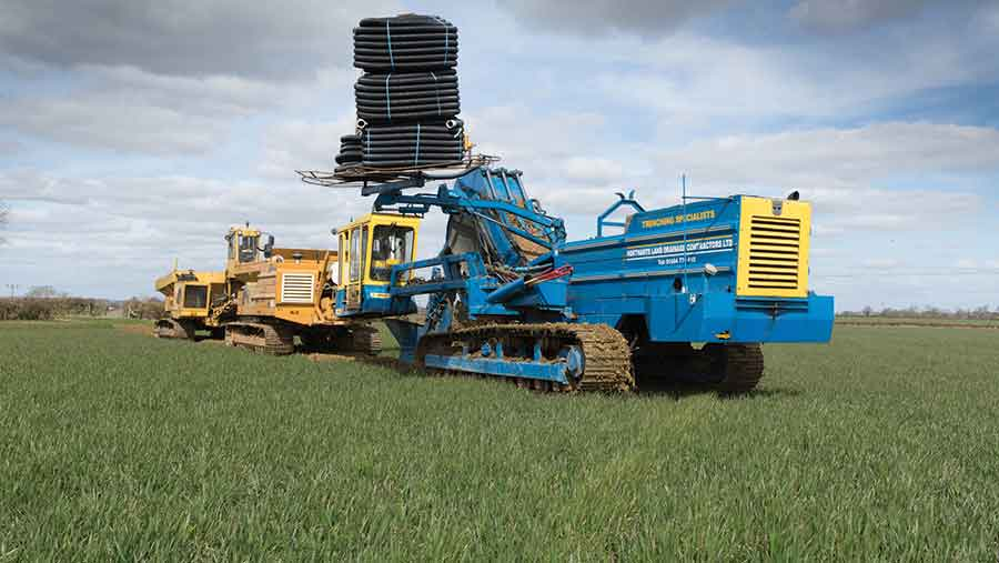 Contractors-draining-a-wheat-field