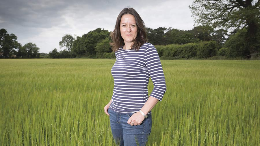 Emily Norton standing in a field