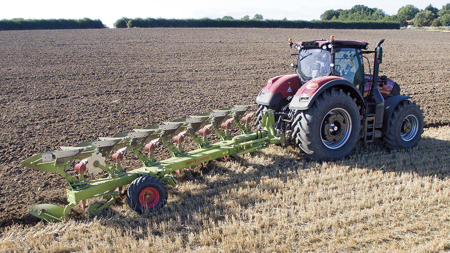 Hubert seven-furrow plough working in a field