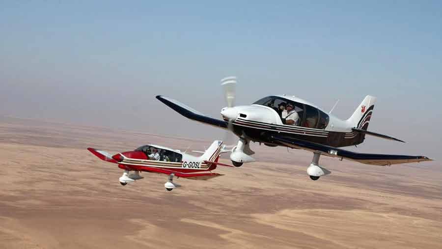 Martin Gosling (red aircraft) and Paul Stephens over the Sahara