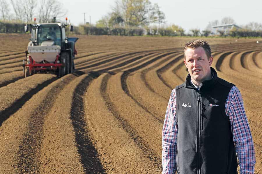 Matt-Alford in a potato field with a tractor