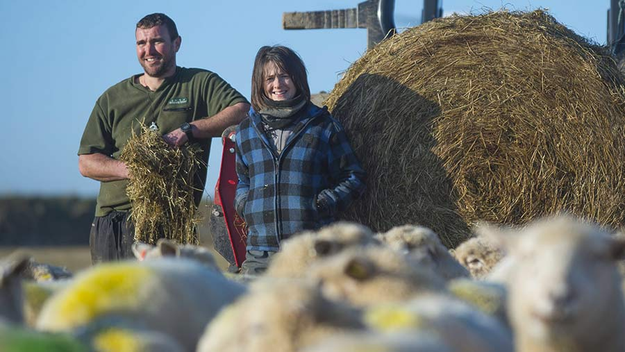Farmers Matt and Pip Smith with some of their flock
