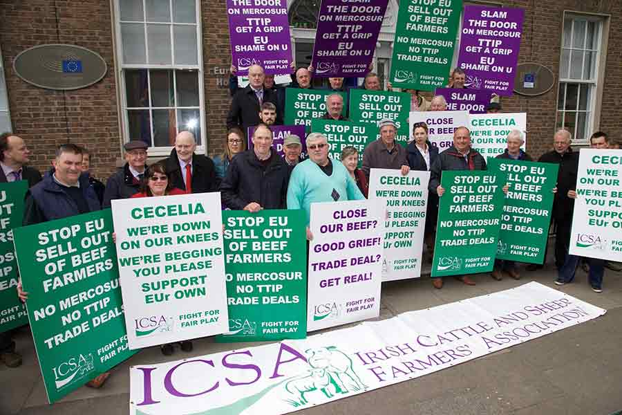 Farmers with banners protest