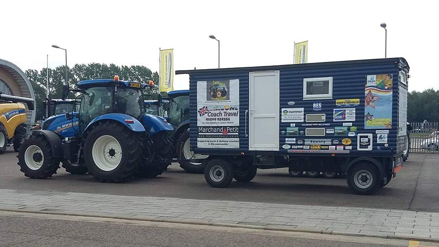 New Holland tractor with shepherd's hut