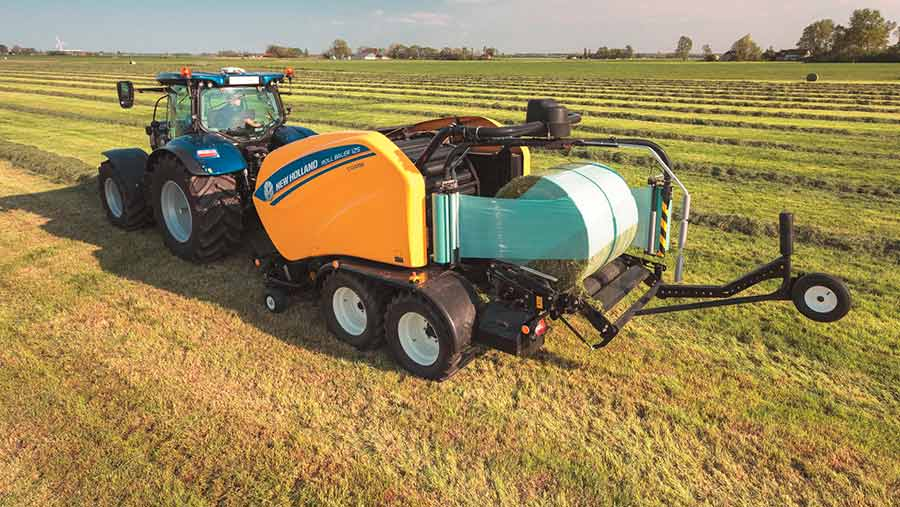 A tractor pulling a baler and wrapper