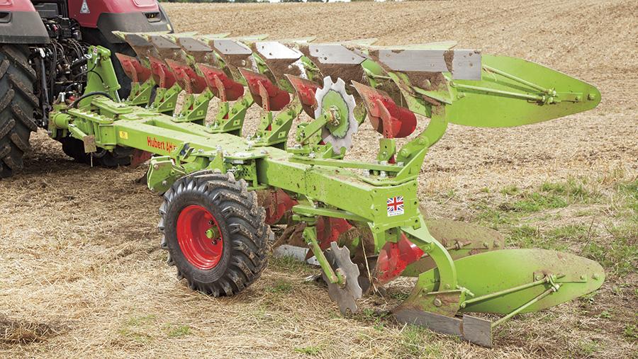 Hubert seven-furrow plough at work
