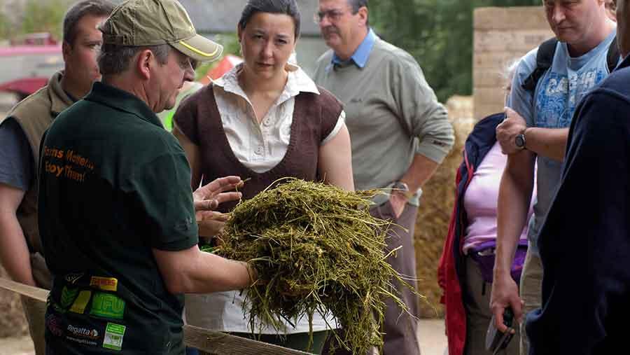 Farmer Ken Goodger explains Chamomile distillation to visitors