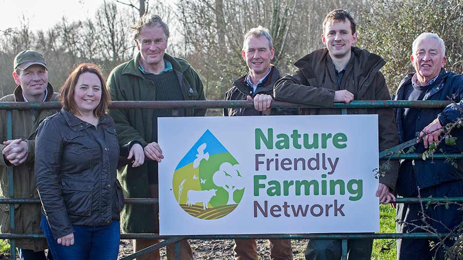 Members of the Nature-Friendly Farming Network standing by a farm gate