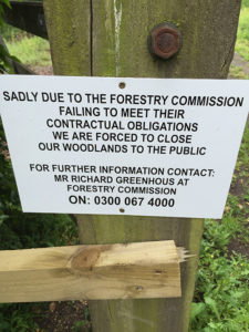 Picture of a sign reading: Sadly due to the Forestry Commission failing to meet their contractual obligations we are forced to close our woodlands to the public. For further information contact: Mr Richard Greenhouse at Forestry Commission On: 0300 067 4000
