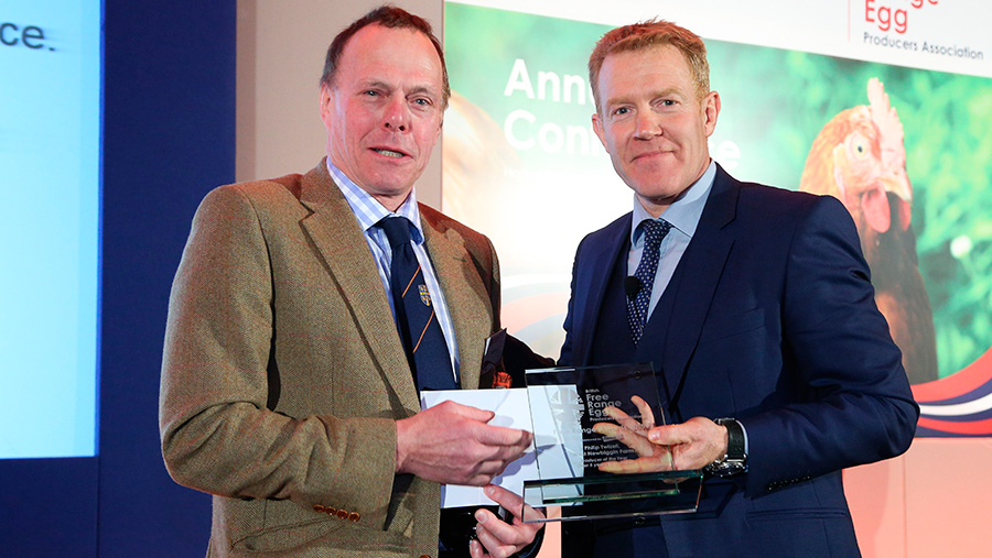 Philip Twizzel is handed his award by Countryfile presenter Adam Henson