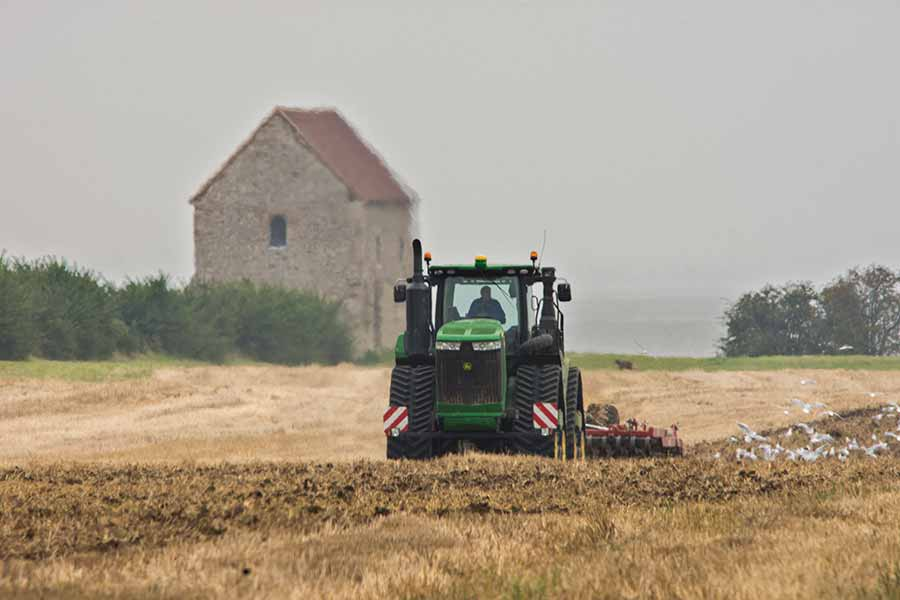 Tractor ploughing in field