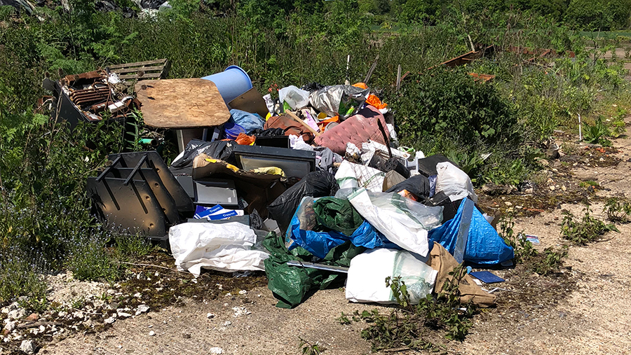 Fly-tipped waste left by travellers on Colin Raynor's farm