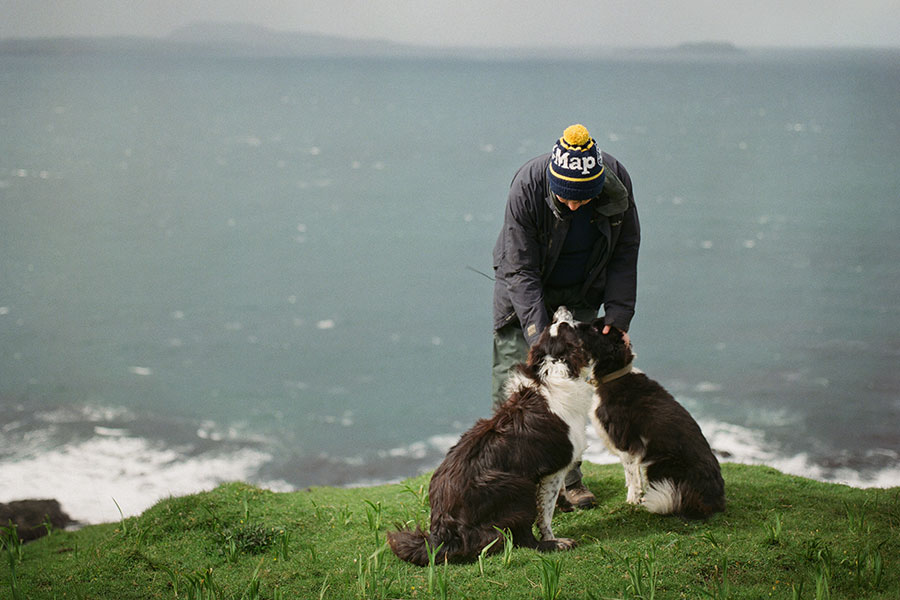 Sarah Boden with dogs by the coast