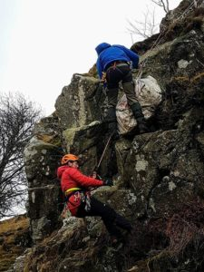 Rescuers abseiling down cligg