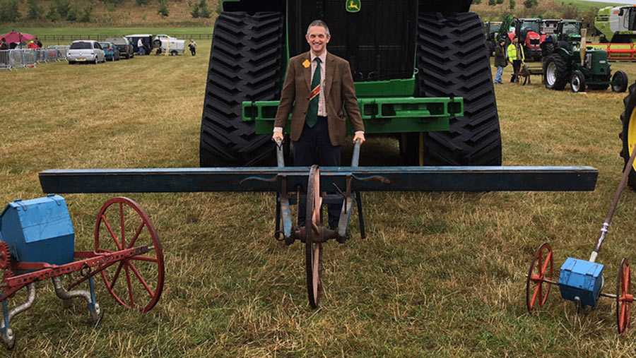 Simon Beddows holding an old drill at  Henley Show