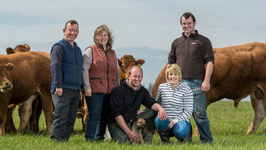 Stephen, Denise, Martin, Melissa and Darren Irvine along with Tilly the dog in a field of cows