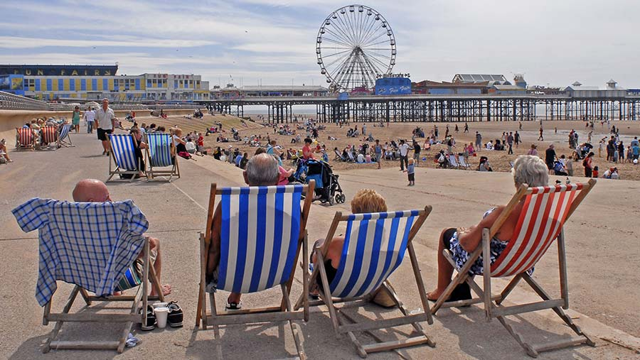 People in deck chairs on the Golden Mile © Peter Lomas/REX/Shutterstock