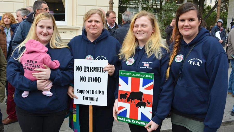 Three-farming-generations with placards---photo-Johann-Tasker
