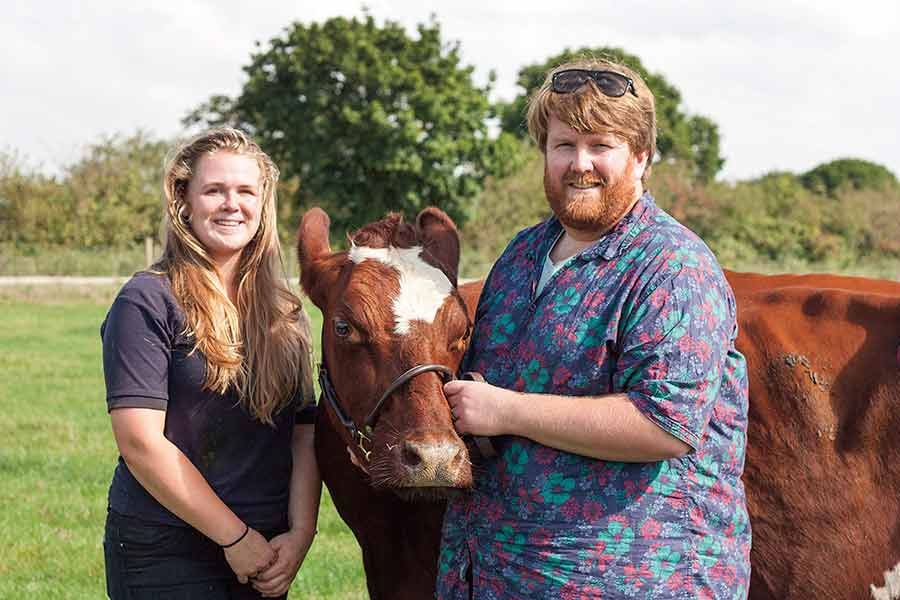 Farm manager Dan Stamper and former-student and herd manager Amy Alywin