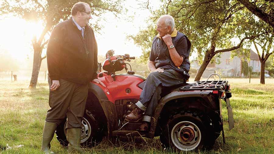 Farmer and worker on quad bike