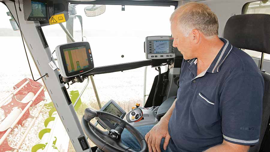 Man sitting in tractor with computer