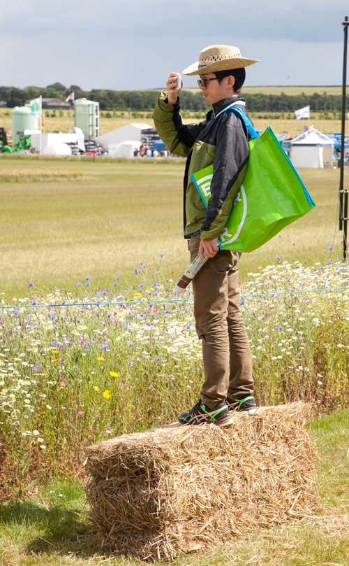 A man standing on a straw bale at Cereals