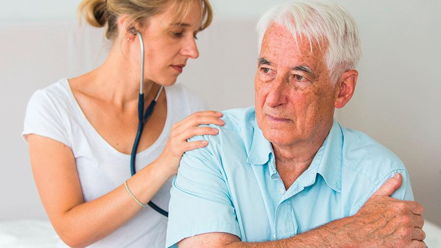 Doctor giving man a medical examination