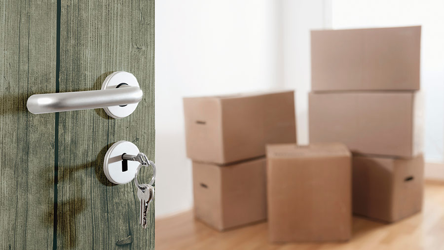 Key in a door, and boxes in the hallway