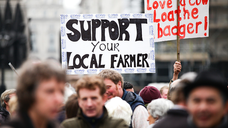 Placard waving farmers at London protest march