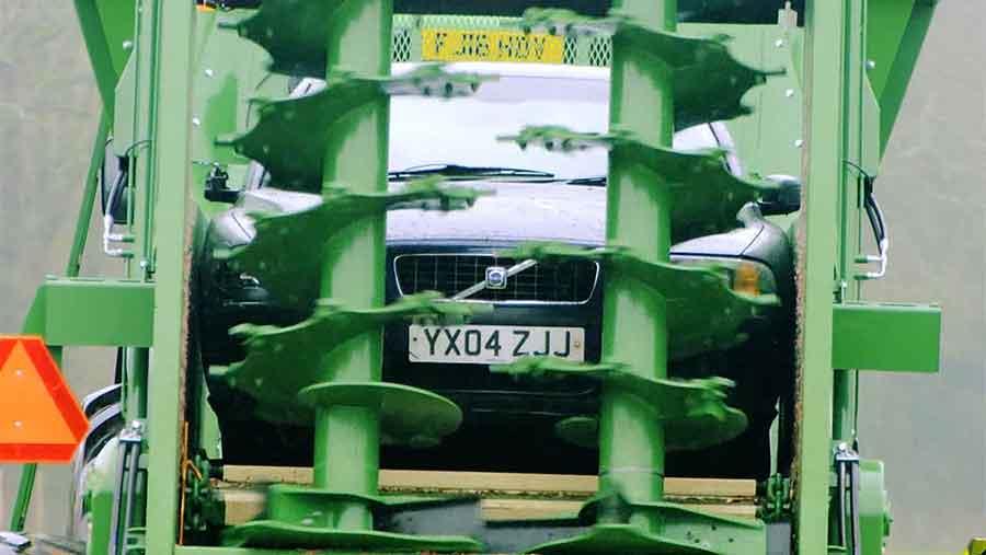 car in muck spreader