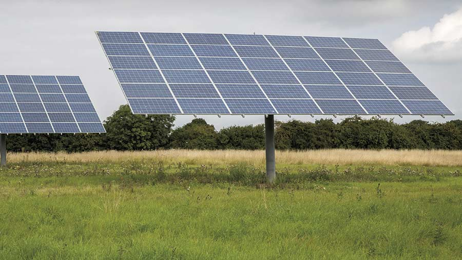 Ground-mounted solar panel in field