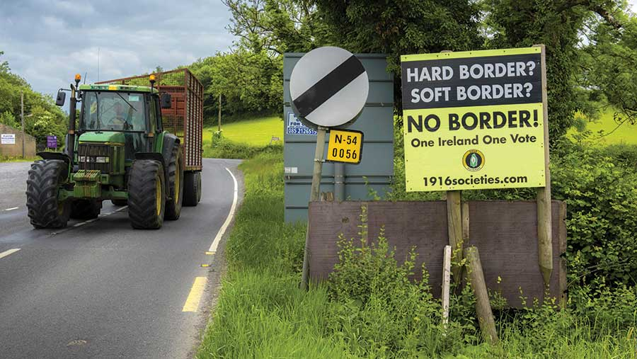 Sign on a country road reads: Hard border? Soft border? No border! One Ireland, one vote