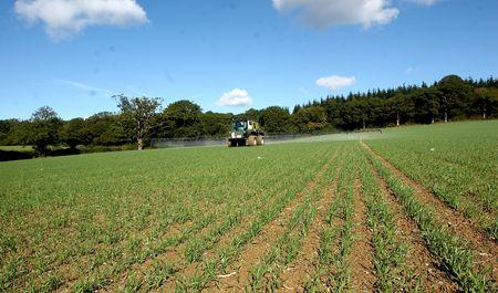 tractor spraying fertiliser