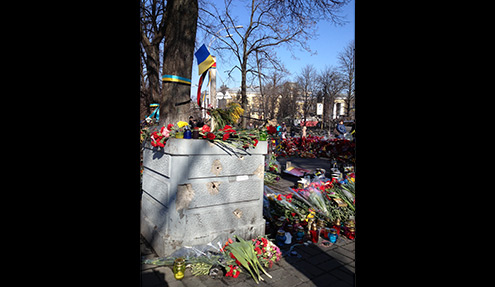 Bullet holes and flowers at shooting site, Kiev