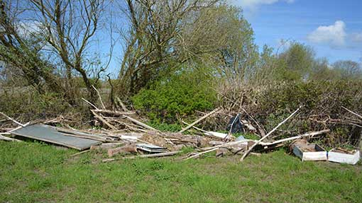 Field corners remain littered with flood debris – including a shed roof, bee hive and fence posts.