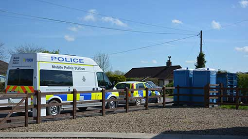 A mobile police station keeps watch over the village of Fordgate