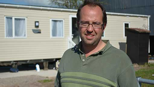 Like many residents, moorland farmer James Winslade is now living in a mobile home.