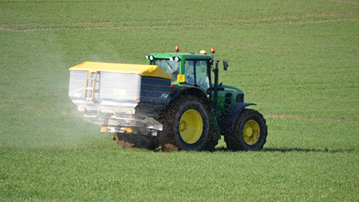 John Deere and KRM fertiliser spreader