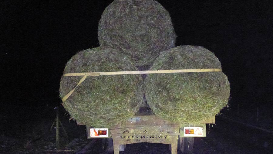 faultry trailer loaded with bales