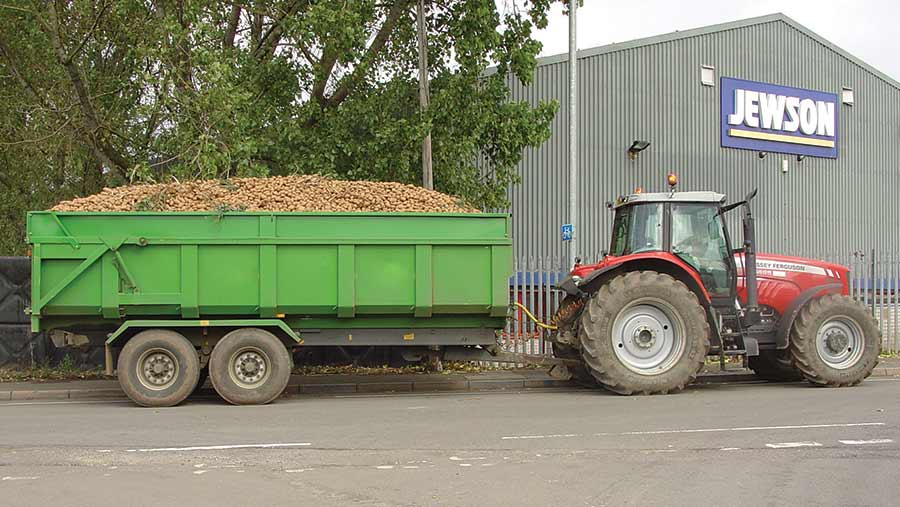 overloaded tractor and trailer